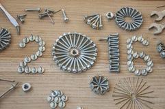 Schroef, spijkers, bout, noot, het nieuwe jaar van 2016 Stock Afbeeldingen