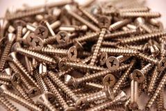 Schroeven - roestvrij staal en hulpmiddelen Stock Foto's