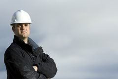 Schroffer Bauarbeiter stockfoto