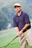Schroffer Golfspieler stockbilder