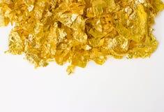 Schroot van gouden folie Stock Afbeeldingen