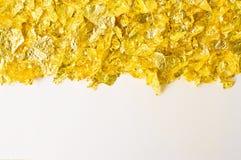 Schrotte der Goldfolie Stockfotografie