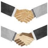 Schuddende handen gerecycleerde document ambacht Royalty-vrije Stock Afbeeldingen