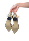 Schuh der Frauenhandholdingkleidergoldhohen absätze Stockbilder