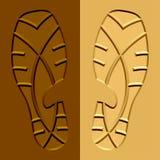 Schuh prägt Schlammsand auf Stockbild