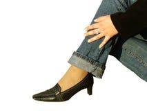 Schuh u. Jeans Stockbild