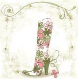 Schuh und Blume. Lizenzfreie Stockfotos