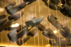 Schuhblöcke, die abstrakte Mode des Hintergrundes hängen lizenzfreies stockfoto