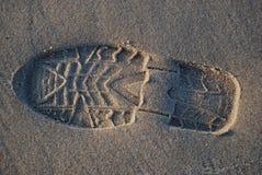 Schuhdruck auf dem Strand Stockfoto