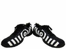 Schuhe auseinander ausgebreitet lizenzfreie stockbilder