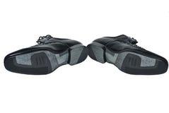 Schuhe der schwarzen Männer auf einem weißen Hintergrund Stockbilder