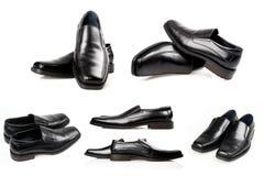 Schuhe der schwarzen Männer auf einem weißen Hintergrund. Stockbilder