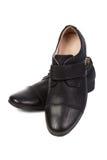 Schuhe des schwarzen Mannes Stockfotografie