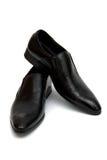 Schuhe des schwarzen Mannes, auf dem weißen Hintergrund Stockfoto