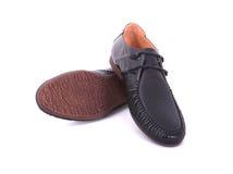 Schuhe für einen jungen Mann Lizenzfreie Stockfotos