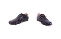 Schuhe für einen jungen Mann Lizenzfreies Stockbild