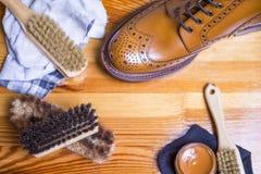 Schuhe-Ideen und Konzepte Nahaufnahme von erstklassiger Tan Brogue Leather Boots stockbild