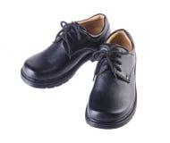 Schuhe, Kinderschuhe auf Hintergrund. Lizenzfreie Stockfotografie
