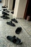 Schuhe und Moschee Lizenzfreie Stockfotos