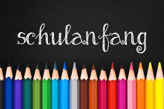Schulanfang (meaning Back to school) written on black chalkboard background Royalty Free Stock Photos