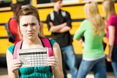 Schulbus: Nicht stolz auf Schulzeugnis-Grade Stockbild
