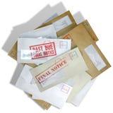 Schuld-Umschlag zerstreuter Stapel Stockfotografie