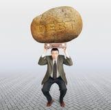 Schuldenaar onder de last van schuld stock afbeelding