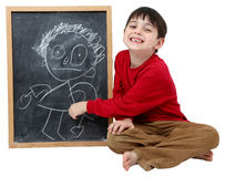 Schule-Jungen-Zeichnung auf Tafel Stockfoto