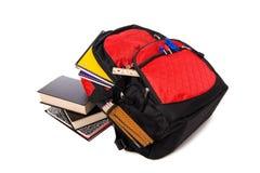 Schule-Rucksack, der mit Zubehör überläuft Lizenzfreie Stockfotos