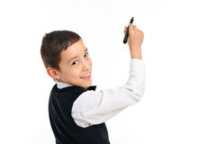 Schulejunge, der mit der Feder getrennt wrighting oder gezeichnet worden sein würden Lizenzfreie Stockfotografie