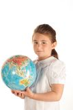 Schulemädchen mit einer Kugel Stockfotos