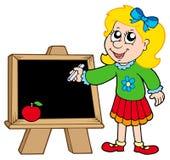 Schulen Sie Mädchenschreiben auf Tafel Lizenzfreie Stockfotos
