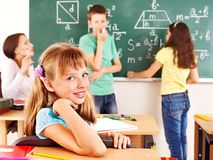 Schulkind mit Lehrer. Lizenzfreie Stockfotografie