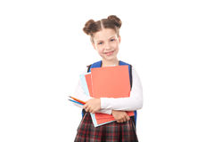 Schulmädchen, das Lehrbücher hält Stockfotografie