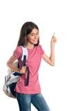 Schulmädchen, das oben auf etwas zeigt Lizenzfreie Stockfotos