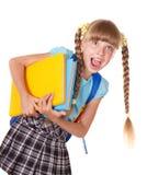Schulmädchen mit Rucksackholdingbüchern. Lizenzfreies Stockbild