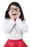 Schulmädchen, welches das Gefühl schüchtern ausdrückt Stockbilder