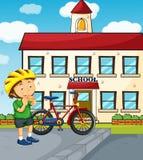 Schulszene mit Jungen und Fahrrad Stockbilder