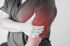 Schulterverletzung in den Menschen schultern Sie die Schmerz, die medizinischen Gelenkschmerzenleute, Monotonhöhepunkt an der Sch Stockbilder
