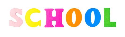 Schulwort mit hölzernen Buchstaben Stockbilder