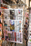 Schutbladen van Italiaanse kranten Stock Afbeeldingen