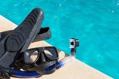 Schutzbrillen und Flossen Stockbild