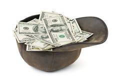 Schutzkappe mit Geld Lizenzfreie Stockbilder