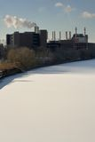 Schuylkill River Factory and Snow. Factory at the edge of the snowcovered Schuylkill River, Philadelphia, PA. Viewed from the Walnut Street Bridge, February 2007 Stock Photos