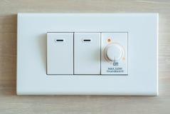 Schwächerer Schalter und Lichtschalter Stockfotos