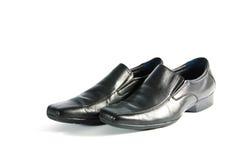 Schwärzen Sie lederne Schuhe lizenzfreie stockfotografie