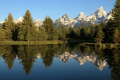 Schwabacher Landing. View from Schwabacher Landing in the Grand Tetons showing symmetrical reflection of mountains and trees in the lake royalty free stock photography