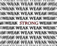 Schwache und starke Wort-Gegenteile im schwarzen Rot stockfotografie