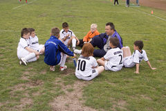 Football trainer with the team discussing the game Royalty Free Stock Photos