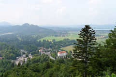 Schwangau in Bavaria, Germany. Schwangau in Bavaria, Germany seen from a distance in a misty summer day Royalty Free Stock Photos